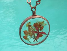 Orange and red real pressed flowers in resin pendant by ArtisanKat, $30.00