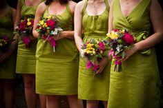 not quite the same color scheme but vibrant bouquets with highlights of magenta with green bridesmaid dresses