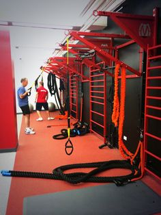 Custom designed wall functional training stations featuring multiple stall bars for group fitness classes.