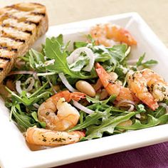 Roasted Rosemary Shrimp with Arugula and White Bean Salad by Cooking Light. Baked shrimp top a crisp salad for a refreshingly light meal in about 15 minutes. Serve with garlic ciabatta. Tea Recipes, Seafood Recipes, Healthy Recipes, Fish Recipes, Roasted Shrimp, Baked Shrimp, Main Dish Salads, Main Dishes, Shrimp Salad