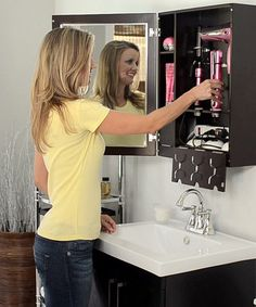 cut down on your morning routine with this styleandgo cabinet that stores your beauty tools where they plug in