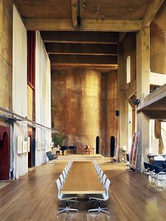 One of my absolute favorite renovations, La Fabrica. Home and workplace of architect, Ricardo Bofill, this monumental structure was a former cement factory. Note the silos at the far end of this conference room. Furniture designed by Bofill. Fotógrafo: Richard Powers.