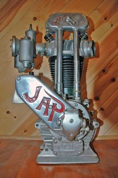 J.A.P. (J.A.Prestwich) 4 stud single cylinder 500cc racing engine is powered by a dual float Amal carburetor, a BTH racing magneto, and a double-acting Pilgrim oil pump.  It features a special finned racing head. Made in Tottenham, England. ca1936.