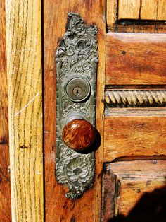 an intricately carved doorplate and richly grained door and knob. Church Street, Old City, Philadelphia