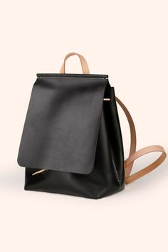 So cute! Simple yet elegant and can be worn with a T and jeans.  Benzoo Black Drawstring Stitching Leather Backpack