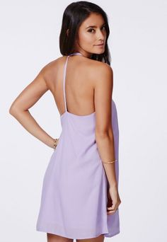 Swing your way into high summer in this super cute little #summerdress, in delightfully pretty #lilac, this is the summer dress we're all adoring here at #Missguided. The easy to rock shape and #halterneck strappy detailing are gorgeous and totally on trend. Style it up with a gold chain necklace and platform heels.