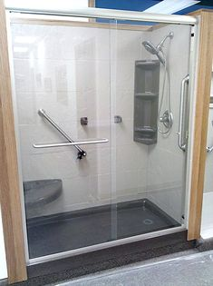 Bathroom Makeover For Elderly onyx shower with sliding glass doors. shower caddies, shower head