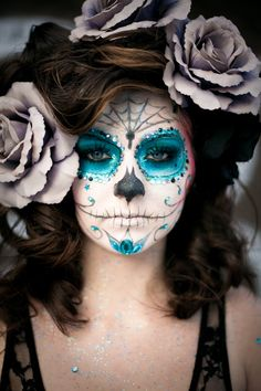 Glamour skeleton makeup. Use Lumiere for the blue, over a base of P-1 white and Black CL-29. Set with Final Seal. Brush on Lumiere Luxe Sparkle Powder. Re-spray with Final Seal. Glue on rhinestones with Spirit Gum.