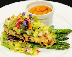 """Hearts and Flowers - Grilled Chicken Breast with a """"Hearts and Flowers"""" Salsa - Hearts of Palm, Tomatillo, and Pineapple Salsa garnished with Edible Flowers and Cilantro Oil...  Thomas Caterers of Distinction 