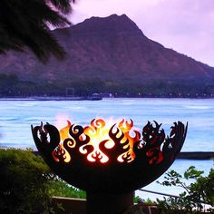 """The Great Bowl O'Fire Recycled Steel Fire Pit by John T. Unger. 37"""" diameter. $1249."""