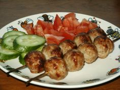 Salikas is dish very similar to a shish kebab. Cubes of pork are marinated, skewered, and then grilled over an open flame or barbeque pit. It is a delicious summer meal served with sauted onions, salad and eaten with a tomato sauce.