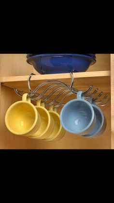 Hooks in the pantry for out of sight mug storage