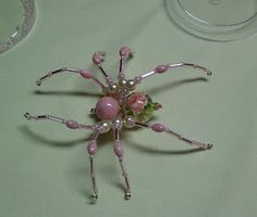 Shawkl: Beaded Spider Tutorial http://www.shawkl.com/2011/09/beaded-spider-tutorial.html