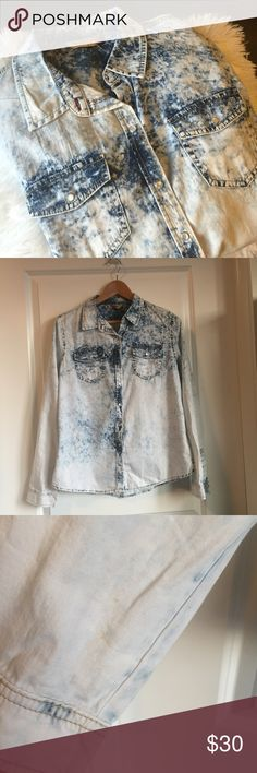 NWOT-Highway Jeans Distressed Denim Top NWOT- Highway Jeans distressed denim button up top. The 4th pic shows a small minor discoloration on the bottom sleeve, hardly noticeable. The back of the top has a super cute cutout. New/Never Worn. Extra buttons attached. Size L. No trades. Thanks Highway Jeans Tops Button Down Shirts