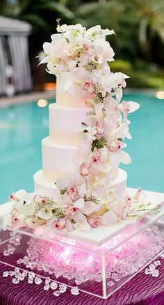 I love the cascading flower idea but I would have this cake only 3 tiers and change the stand