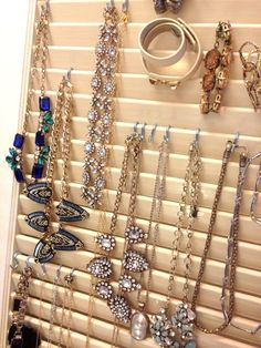 With a growing collection of jewelry, it is great to have an organizer that will grow with your collection. An old louver style door is great for this when combined with some S hooks. This w...