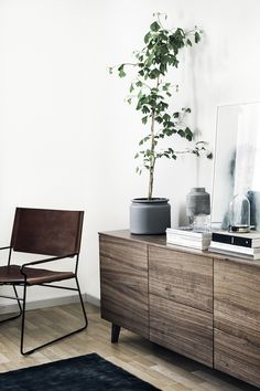 Wood credenza in a Finnish home in striking charcoal tones. Designer: Laura…