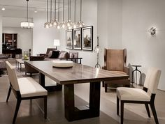 nice Salle à manger - Contemporary dining room. Love the modern wood dining table, the chandelier ligh...