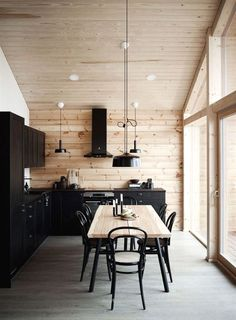 I like the way the black looks on the lighter wood but I feel like its overwhelming with black and why would you want black cabinets house interior Modern Interior Design of a Log House Plays with Contrasts - Honka Modern Cabin Interior, Modern House Design, Decor Interior Design, Interior Decorating, Natural Modern Interior, Modern Cabin Decor, Decorating Ideas, Beautiful Houses Interior, Modern Loft
