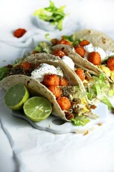 sweet potato tater tots tacos with scrambled eggs and salsa verde