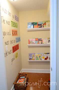 books on wall for under stairs play room (have brett make vinyl decals for wall)