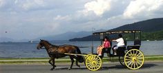 "#LakeGeorge, NY- ""Clip clop, Clip clop"" the quaint sound of the horse's hoofs provides the background music to the panoramic views of Lake George you are witnessing as your carriage rolls along its shore. No trip to Lake George is complete without the traditional carriage ride through the beautiful beach front area."