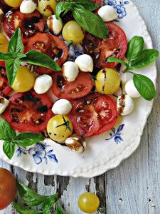 Caprese salad using locally grown St. Louis tomatoes, a perfect side dish for your backyard barbeque!