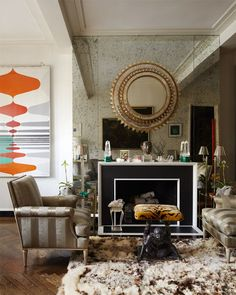 Trend: mirror hung over mirrored wall. Todd Alexander Romano