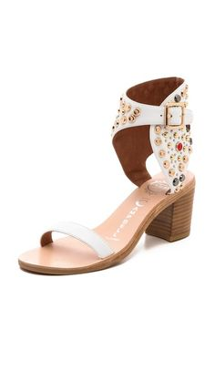 Jeffrey Campbell Seneca Studded Sandals. Glittering rhinestones and mixed studs detail the wide ankle cuff on leather Jeffrey Campbell sandals.