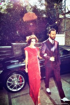 Car: Aston Martin Rapide S. Her: Couture gown by COLUNGA. Jewellery by Daniela Norinder. Him: Shirt, suit & shoes by Vivienne Westwood Man. Necktie by COLUNGA.
