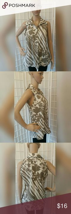 Nwot Button down sleeveless top shirt Nwot Button down sleeveless top shirt   Olive white  Excellent condition no flaws   Material content  68% polyester 32% viscose   Measurements aprox  Chest 36in Length 27.5in LUNDSTROM Tops Button Down Shirts