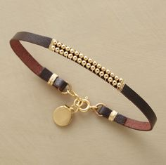 Wired by hand to dark brown leather, 14kt goldfill beads line up two by two.