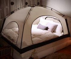 Conserve heat and lower your electric bill throughout the cold winter months by setting up this room in a room. The small tent fits directly over your existing bed, can be fitted with a light, and features a mesh top designed to ventilate the air.