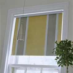 DIY painted vinyl shade - great way to add style to boring window treatments.