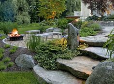 I love these natural stone steps, but would add a bench or partial wall along the fire pit area.