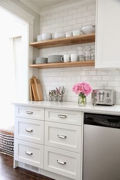 white kitchen, wood shelves, pretty details