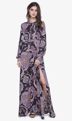 A demure look that purrs with sexy details. The bold paisley print, long, romantic poet sleeves and high neckline get some spice added with a high slit in the skirt and a surprising open back.