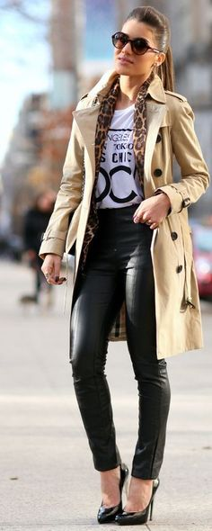 Shop this look on Lookastic:  http://lookastic.com/women/looks/sunglasses-pumps-skinny-pants-trenchcoat-crew-neck-t-shirt-scarf/8470  — Dark Brown Sunglasses  — Black Leather Pumps  — Black Leather Skinny Pants  — Tan Trenchcoat  — White and Black Print Crew-neck T-shirt  — Brown Leopard Scarf