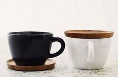 Love these cups: colors, shape, the wooden saucer that smartly becomes a cover. By Hoganas Keramik