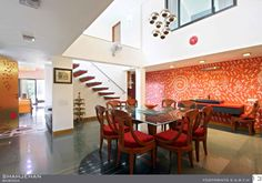 Large Dining Area with red wallpaper- Design by  Architect: YATIN PANDYA, India