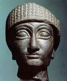Stone head of priest-king Gudea of Lagash (southern Mesopotamia)  14cm high and 11cm wide.   From the early bronze era. 2143-2124 BC   Source: Leiden Museum of Antiquities