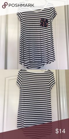 Navy Striped Pocket Tee White and Navy stripe tee with floral pocket. Super soft, flowy material. 95% rayon, 5% spandex. Worn once! downeast Tops Tees - Short Sleeve