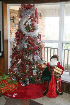 Roll Tide Roll.....This is my mom's Christmas tree from 2012. She made almost all the ornaments!
