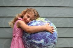 Photo by Justin Craig - Earth, hugging, hug, love, youth, girl, dress, future, hands, Earth Day, spring, springtime