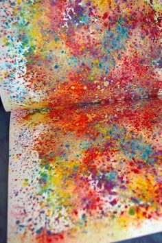Water color crayons. Shaved onto the paper with a sharpener, then sprayed with water and sandwiched between paper and ironed.