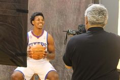Guard Nick Young smiles for the cameras to get things started at Sixers Media Day 2012
