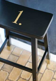 Black bar stool makeover  Gold dipped legs  Gold painted numbers