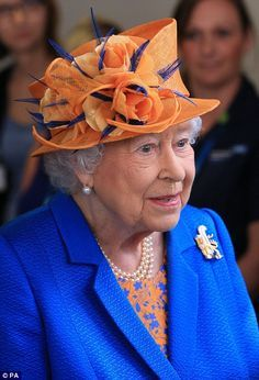 Vibrant: The Queen opted for an electric blue coat, printed dress and orange hat