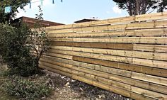 Fencing, consider, smooth lines running out, with careful meets of the planks to get a continuous line, for a boundary line.