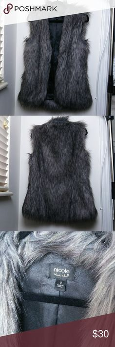 Nicole Miller grey faux fur vest This vest features pockets, and no closure hardware. Very warm and in great shape. Nicole Miller Jackets & Coats Vests